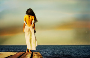 lonely-girl-looking-out-to-sea